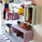 gorgeous modern and floating shoes and boot storage idea with purple and soft blue color on white wooden siding and tile flooring and purple rug