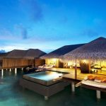 Gorgeous Resort Idea With Hut And Modern Lighting And Swimming Pool And Floating Idea On The Ocean