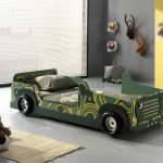 green-army-car-bed-design-for-kids-with-green-pillos-and-the-grey-color-floor-and-wall-and-a-doll-and-a-beige-carpet