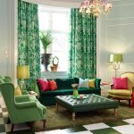 green tone living space with green chaise and green wing chair and green tufted coffee table and green area rug and yellow accent and pink