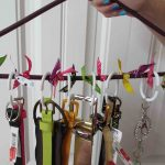 homemade belt storage ideas with hanger beautified with colorful ribbons