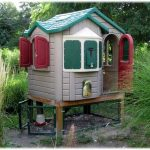 interesting-chicken-coop-made-from-an-unused-playhouse-with-red-windows-and-door-and-green-roof-placed-in-the-backyard