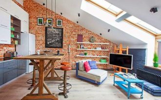 interior with loft idea of living room with red brick wall and skylight and blue accet and wooden bar table and orange stools