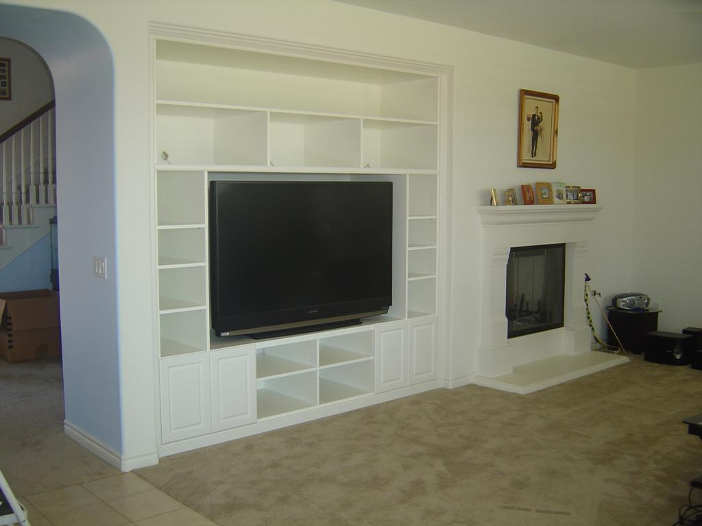 large in wall entertainment center in white scheme with shelves and