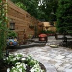 Large Walkway Backyard Patio Design With Paved Flooring And Small Garden And Firepit And Wooden Bench And Wooden Fence And Lantern And Hanging Pots