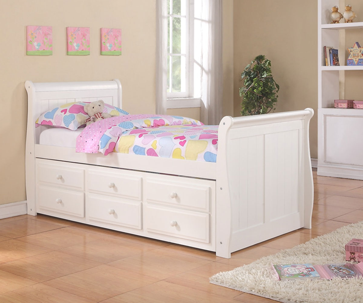lovable white pop up trundle bed frame idea with simple headboard and corner potter plant and