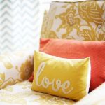 lovely coral color throw pillow idea on yellow sofa with yellow cushion and chevron curtain