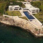 luxurious and uniuqe dream private house design on coastal area with green surrounding facing ocean with long pool