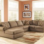 luxurious creamy sectional sofa design with leopard print cushiosna nd brown area rug and orange siding and glass window
