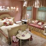 luxurious-girls-Bedroom-with-princess-themed-bedroom-and-pink-wall-color-and-wall-lamps-and-table-lamps-on-the-white-dresser-also-dolls-on-the-white-table-also-wooden-floor