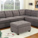 Luxurious Gray Tufted Sectional Sofa Design With Pouf Coffee Table And White Rug And Wooden Floor And Shelves And Glass Window