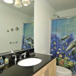 luxurious-sea-themed-bathroom-design-with-large-mirror-and-sea-themed-shower-curtains-for-kids-bathroom-with-white-wall-and-white-sink