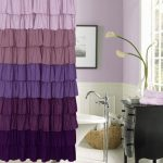 luxurious spring mood bathroom with ombre purple curtain with sleeve and black vanity with tree lamp and white tub