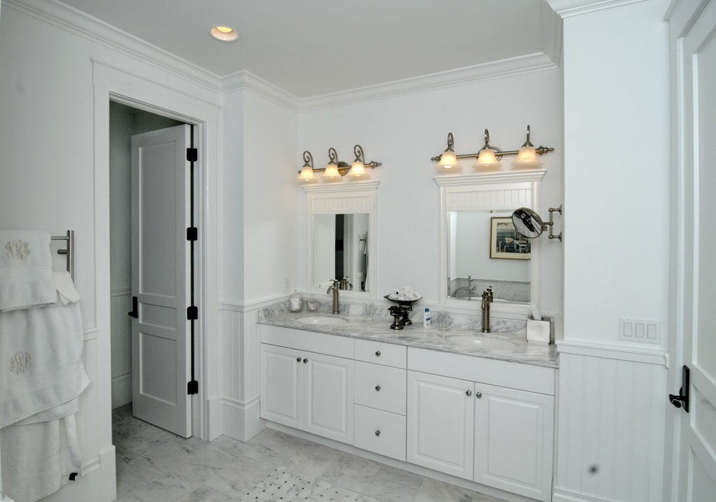 luxurious white bathroom idea with beadboard and towel hanger and long  white vanity and wall mirrors. Bathroom with Beadboard   Classic Style   HomesFeed