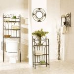 metal scrolled towel shelf for bathroom idea with hanger and potted plant and wall rack and white siding