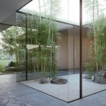 mini indoor greenhouse idea with bamboo and glass box and skylight and paved area and white ceiling