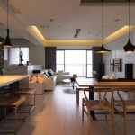 minimalist kitchen loft design with kitchen bar and cone pendants and unique square stools and beige wooden dining table with unique chairs