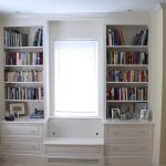 minimalist window seats completed with storage made of wood combined with book shelf