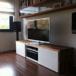 minimalist wooden white ikea stereo cabinet design beneath bookshelves on wooden floor with glass window