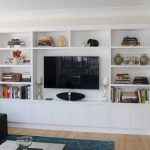 modern and classy in wall entertainment center with storage for media and book accessorized with decorative objects for living room ideas