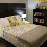 modern bedroom idea with gray and yellow decoration with black wooden headboard combination and yellow nightstand and white table lamps