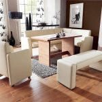 modern corner dining table set idea with white sofa banquette anc bench and wooden table and black area rug and wooden floor and floor lamp and curtain and glass window