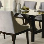 modern dining room idea with small rectangular dining table with glass top and comfy dining chair plus light rug