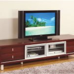 modern entertainment system furniture with 2 glass door and drawers for media storage plus grey rug on wooden floor
