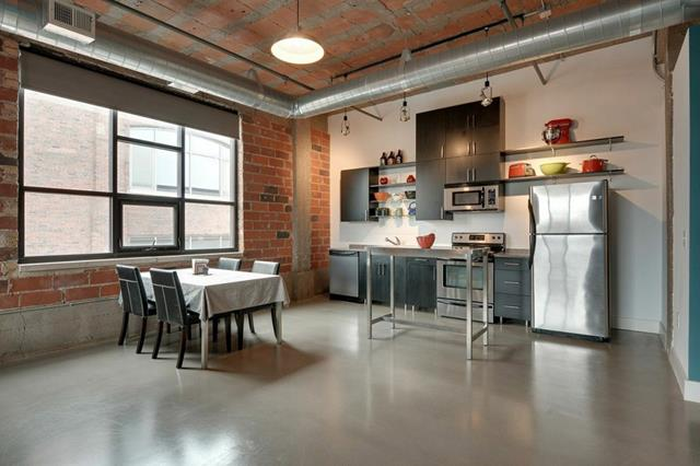Modern Industrial Loft Kitchen Design With Large Glass Window And White  Dining Table With Black Chairs