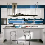 modern kitchen idea wih blue accent and open concept and white island with home bar and white stools