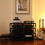 modern metal ikea stereo cabinet idea on wooden floor beneath white wall with picture
