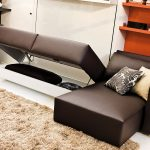 modern murohy bed design with brown leather couch idea with orange racks and creamy rug