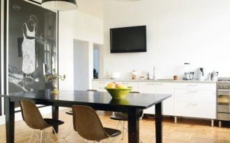 modern-simple-dining-room-with-eames-molded-plastic-brown-chairs-and-black-dining-table-also-black-pendant-lamps-with-tv-on-white-wall-also-big-photogallery