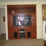 modern walnut in wall entertainment center for living room ideas with media storage and a display shelf on the top for accessories