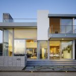 modern whote two storey house design with open plan and glass facade idea and concrete patio
