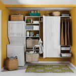 modern yellow laundry room with basket shelves and closet and white flooring and yellow painted wall