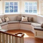 most cozy bay window with sectional window seats with storageand decorative cushions plus wooden floor