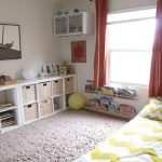 nice-toddler-floor-bed-with-rug-and-white-yellow-floor-bed-and-long-horizontal-shelves-also-floating-shelf-near-window-with-red-curtain