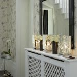 nice-tree-silhouete-mirror-candle-holders-on-the-shelf-and-mirror-with-black-frame-combined-with-white-flowers