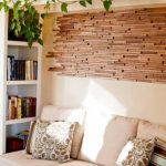 Nice Wall Decoration With Reclaimed Wood Wall Tiles And White Ladder Shelf For Ivy Plants And Sofa Near Bookshelf