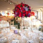 nice-wedding-decoration-idea-with-colorful-centerpieces-like-red-roses-and-purple-and-blue-flowers-also-as-a-flower-tower-with-its-tall-stand