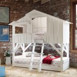 nice-white-tree-house-bunk-bed-with-pillows-and-red-blanket-near-brick-wall-and-on-the-wooden-floor-also-white-flowers-and-large-window