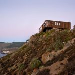 on cliff rustic beach home design with boxy style on rocky mountain with ocean view