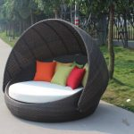 outdoor cheap round bed design with white bolster and colorful pillows and canopy made of rattan