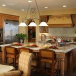 pendant-lamps-over-the-kitchen-island-with-brown-wooden-chairs-and-wooden-floor