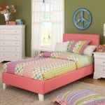 pink full size toddler bed decorated with modern nightstand and cute bedding plus and modern rug and wooden dresser plus green wall