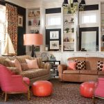 playful living space with coral color sofa and pouf and floor lamp and cushion on caramel color sofa idea