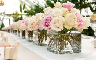 pretty-and-sweet-short-and-low-centerpieces-on-wedding-reception-tables-decorations-with-white-and-pink-roses-in-square-glass-containers-with-water