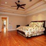 recessed ceiling fan in classic style a bed furniture with wooden headboard a pair of bedside tables with drawer system higher TV desk with storage