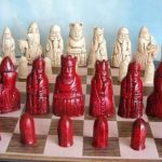 red-and-white-pieces-with-chessboard-known-as-the-Isle-of-Lewis-chess-set-as-featured-in-the-harry-potter-movie-